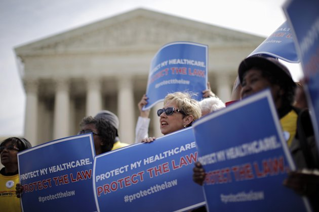 In this March 28, 2012 file photo, supporters of health care reform rally in front of the Supreme Court in Washington on the final day of arguments regarding the health care law signed by President Barack Obama. Congressional budget analysts are now estimating that nearly 6 million Americans, most of them in the middle class, will have to pay a tax penalty for not getting health insurance once Obama's health care law is fully in place. That's 2 million more than a previous estimate found, or a 50 percent increase. Starting in 2014, the new health care law requires virtually every legal resident of the U.S. to carry health insurance, or face a tax penalty. The Supreme Court upheld Obama's law as constitutional after finding that the penalty fell within the power of Congress to impose taxes.
