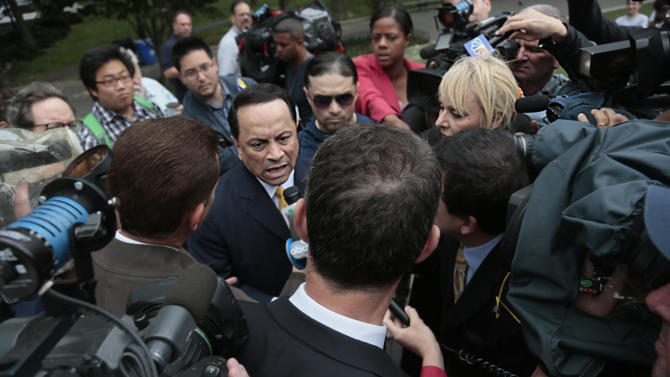 Former state Sen. Pedro Espada Jr., center, speaks as he arrives at Brooklyn federal court on Friday, June 14, 2013 in New York. Espada could face seven years in prison at sentencing after pleading guilty to tax fraud charges. (AP Photo/Bebeto Matthews)