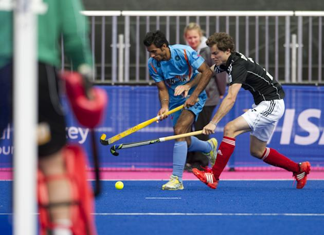 "India's Gurbaj Singh (L) vies with Germany's Oskar Deecke during their International Invitational Hockey Tournament match, part of the ""London Prepares"" series of test events, at the Riverbank Arena a"