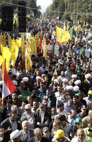 Tens of thousands of people take part in Lebanon's eastern city of Baalbek, Lebanon, Friday, Sept. 21, 2012, for the latest in a series of protest rallies organized by the Shiite militant group Hezbollah. Anger over insults to Islam's Prophet Muhammad isn't enough to bring Lebanon's divided Sunni and Shiite Muslims together. The two sects, which have been locked in sometimes violent political competition, hold separate protests. A hardline Sunni cleric accuses Shiite Hezbollah of using the protests to distract from the fighting in neighboring Syria. (AP Photo/Bilal Hussein)