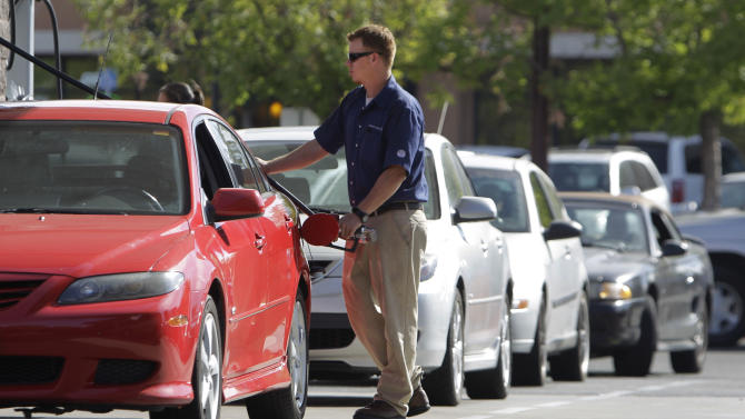 Cars line up to get gas at a Costco gas station in Sacramento, Calif., Friday, Oct. 5, 2012. Californians woke up to a shock Friday as overnight gasoline prices jumped by as much as 20 cents a gallon in some areas, ending a week of soaring costs that saw some stations close and others charge record prices. The average price of regular gas across the state was nearly $4.49 a gallon, the highest in the nation, according to AAA's Daily Fuel Gauge report. (AP Photo/Rich Pedroncelli)