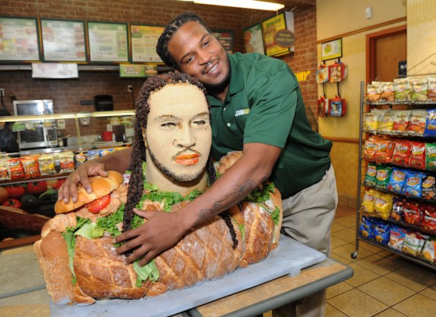 "IMAGE DISTRIBUTED FOR SUBWAY -Linebacker Jarvis Jones, 2013 draft prospect and newest Famous Fan of SUBWAY, unveils a life-size ""Smokehouse BBQ Chicken"" sculpture to announce his official SUBWAY Famou"