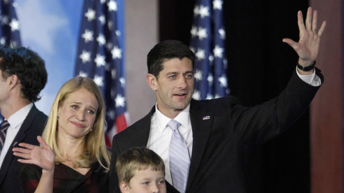 Republican vice presidential candidate, Rep. Paul Ryan, R-Wis., his wife Janna and their son Charlie wave to supporters after Republican presidential candidate and former Massachusetts Gov. Mitt Romney conceded the race at his election night rally, Wednesday, Nov. 7, 2012, in Boston. (AP Photo/Stephan Savoia)