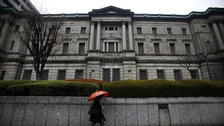 Woman walks past BOJ headquarters in Tokyo