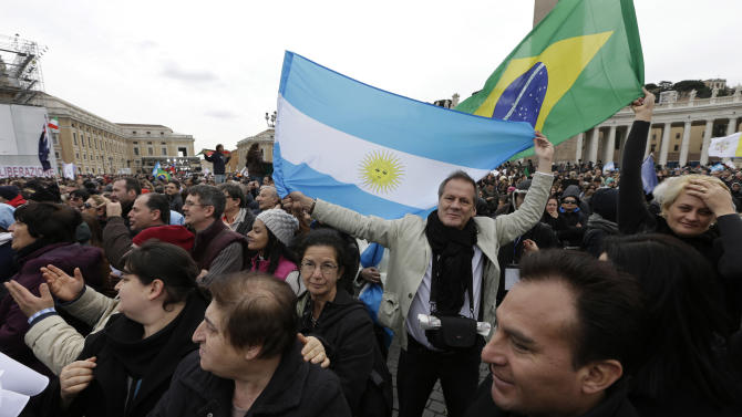 Visitors wave flags from Argentina and Brazil before the Angelus prayer by Pope Francis in  St. Peter's Square at the Vatican, Sunday, March 17, 2013. (AP Photo/Alessandra Tarantino)