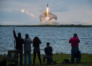 Spectators cheer as the United Launch Alliance Delta …