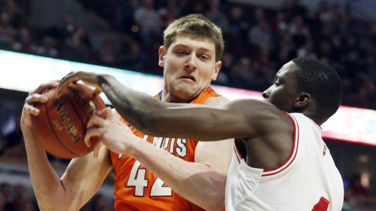 Illinois' Tyler Griffey (42) and Indiana's Victor Oladipo (4) go after a rebound during the first half of an NCAA college basketball game at the Big Ten tournament Friday, March 15, 2013, in Chicago. (AP Photo/Charles Rex Arbogast)