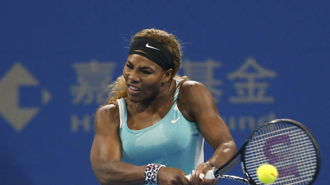 Serena Williams of the U.S returns a shot against Lucie Safarova of the Czech Republic during the China Open tennis tournament at the National Tennis Stadium in Beijing, China, Thursday, Oct. 2, 2014. (AP Photo/Vincent Thian)