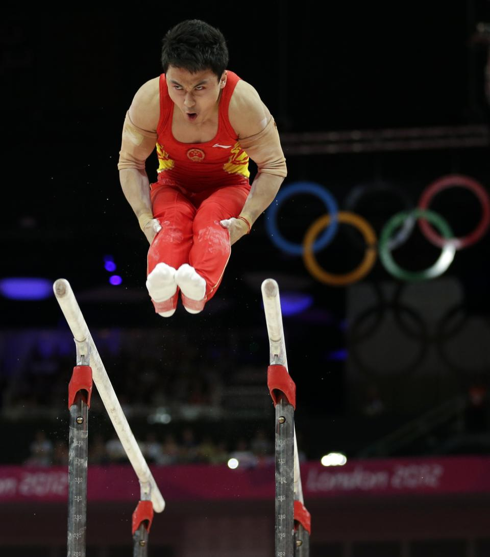 Chinese gymnast Feng Zhe performs on the parallel bars during the artistic gymnastics men's apparatus finals at the 2012 Summer Olympics, Tuesday, Aug. 7, 2012, in London. (AP Photo/Gregory Bull)