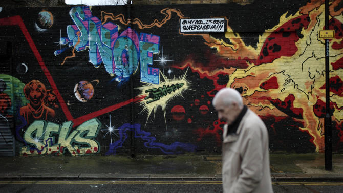 A man walks past street art in east London, Thursday, Dec. 20, 2012. The clock is ticking down to Dec. 21, the supposed end of the Mayan calendar, and from China to California to Mexico, thousands are getting ready for what they think is going to be a fateful day. The Maya didn't say much about what would happen next, after a 5,125-year cycle known as the Long Count comes to an end. So into that void have rushed occult writers, bloggers and New Age visionaries foreseeing all manner of monumental change, from doomsday to a new age of enlightenment. (AP Photo/Matt Dunham)