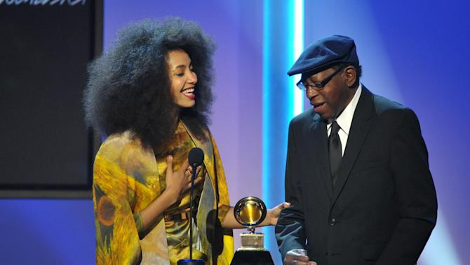 """Esperanza Spalding, left, and Thara Memory, right accept the award for instrumental arrangement with vocalists for """"City of Roses"""" at the 55th annual Grammy Awards on Sunday, Feb. 10, 2013, in Los Angeles. (Photo by John Shearer/Invision/AP)"""