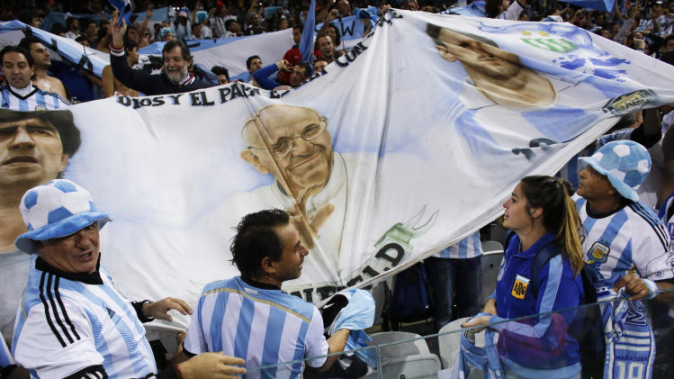 Argentine fans unravel a banner in the stands after Argentina defeated the Netherlands 4-2 in a penalty shootout after a 0-0 tie after extra time to advance to the finals after the World Cup semifinal soccer match between the Netherlands and Argentina at the Itaquerao Stadium in Sao Paulo Brazil, Wednesday, July 9, 2014. (AP Photo/Victor R. Caivano)