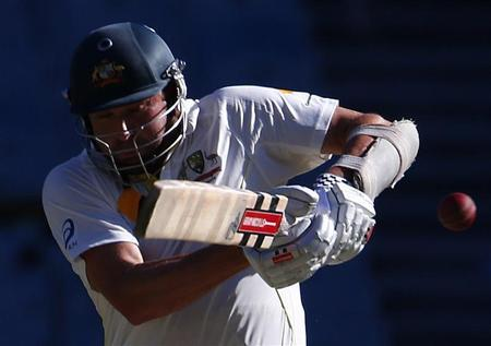 Australia's Harris plays a shot before he was caught out by England's Root during the second day of the fourth Ashes cricket test at the Melbourne cricket ground