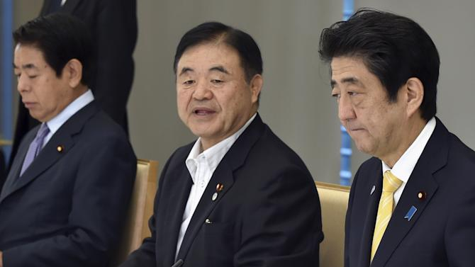 Japan's Olympics Minister Endo speaks during a meeting of Cabinet ministers on a new National Stadium construction plan for the 2020 Tokyo Olympics at Abe's official residence in Tokyo