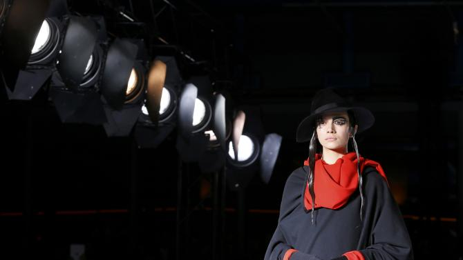 A model presents a creation by Japanese designer Yohji Yamamoto as part of his Autumn/Winter 2015/2016 women's ready-to-wear collection during Paris Fashion Week