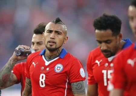 Chile's Arturo Vidal leaves the pitch with his teammates at halftime during their Copa America 2015 final soccer match against Argentina at the National Stadium in Santiago