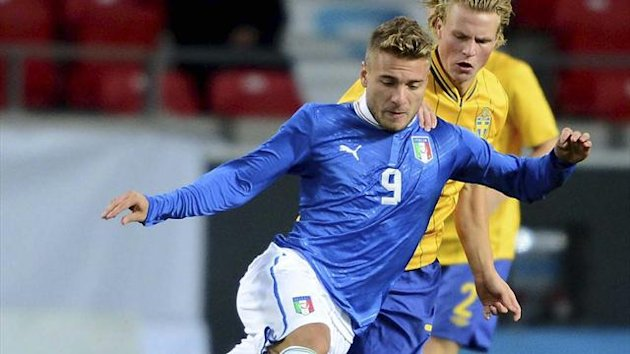 Italy's Ciro Immobile (L) and Sweden's Oscar Hiljemark fight for the ball during the European Under-21 Championship (Reuters)