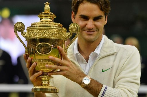 Switzerland's Roger Federer celebrates with the trophy