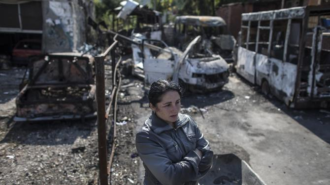 A woman stands in an area that was recently shelled in Donetsk, eastern Ukraine