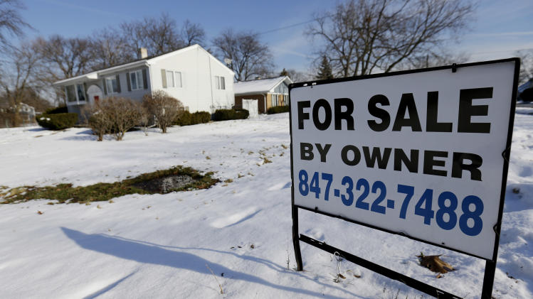 In this Friday, Dec. 27, 2013, photo, a home is for sale in Glenview, Ill. Freddie Mac reports on changes in average fixed mortgage rates for the last week of 2013 on Thursday, Jan. 2, 2014. (AP Photo/Nam Y. Huh)