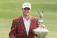 Zach Johnson poses with the trophy after his one-stroke victory at the Crowne Plaza Invitational at Colonial at the Colonial Country Club in Fort Worth, Texas, on May 27. Johnson fired a two-over 72 that included a two-shot penalty at the final hole to win the event, denying Jason Dufner a third US PGA victory this season