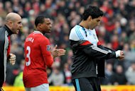 Patrice Evra (left) and Luis Suarez
