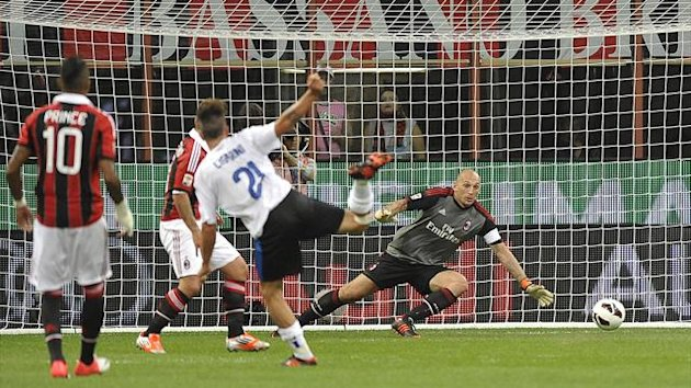 Luca Cigarini scores the only goal as Atalanta defeat AC Milan at the San Siro (Reuters)