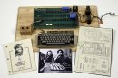 "This undated photo provided by Christie's Auction House shows an ""Apple 1"" prototype computer, built in 1976, accompanied by an operation manual and schematic as well as a photo of its inventors, Steve Wozniak, left, and Steve Jobs. One of the very first Apple 1 computers, it goes on sale later this month at Christie's auction house, the latest in a recent run of vintage tech sales that have attracted some eye-popping prices. (AP Photo/Christies Images Ltd. 2013)"