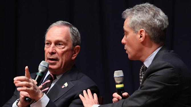 """New York City Mayor Michael Bloomberg, left, and Chicago Mayor Rahm Emanuel, take part in a forum on education at American University in Washington, Friday, March 2, 2012. Bloomberg uses his radio show to respond to New Jersey officials' criticism of the New York Police Department's surveillance of Muslims, saying it is a """"bit ridiculous"""" to suggest the NYPD shouldn't cross the same state line that Sept. 11 terrorists did. (AP Photo/Jacquelyn Martin)"""