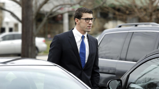 Olympic swimmer Michael Phelps walks into a courthouse for a trial on drunken driving and other charges, Friday, Dec. 19, 2014, in Baltimore. Documents show that the 29-year-old was leaving Baltimore's Horseshoe Casino Sept. 30 when he was pulled over for speeding and crossing the double yellow line on a highway. Police say Phelps registered a .14 per cent on a blood-alcohol test. The legal limit to drive is .08 per cent in Maryland. (AP Photo/Patrick Semansky)