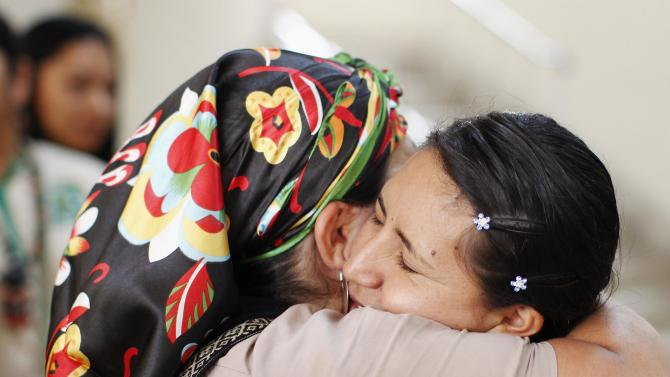Women embrace after performing a ritual celebration before a meeting in Lima, of delegations of indigenous women
