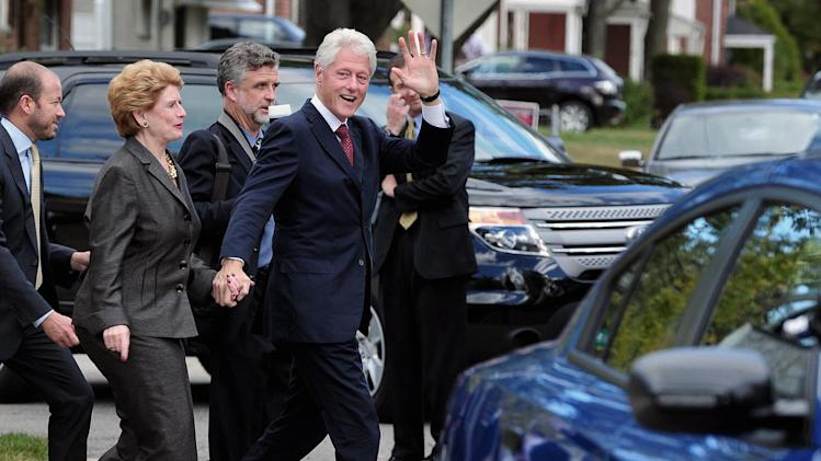 Former President Bill Clinton walks hand in hand with U.S. Senator Debbie Stabenow, D-Mich. during a fundraiser for President Obama/Stabenow in Royal Oak, Mich., Friday,  Oct. 12, 2012.  (AP Photo/Detroit News, Ricardo Thomas)  DETROIT FREE PRESS OUT; HUFFINGTON POST OUT; MANDATORY CREDIT