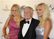 Playboy magazine founder Hugh Hefner and girlfriends Anna Sophia Berglund (L) and Shera Bechard arrive at the Society of Singers annual dinner in Beverly Hills, California September 19, 2011. REUTERS/Fred Prouser