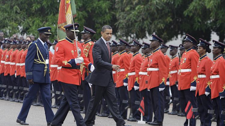 FILE - In this Saturday, July 11, 2009 file photo, U.S. President Barack Obama, center, reviews members of the Ghanaian military at the Presidential Palace in Accra, Ghana. President Barack Obama promised to visit his father's homeland of Kenya before the end of his presidency but of the 51 country visits Obama made in the last four years, America's first black president spent less than a day in sub-Saharan Africa. Obama is likely to spend more time in Africa in his second term, a presidential historian said. Freed of domestic campaign politics, second-term presidents can travel more in a continent that has less strategic importance than Europe and Asia. (AP Photo/Haraz N. Ghanbari, File)