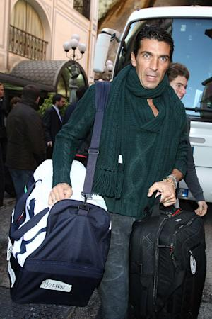 Juventus goalkeeper Gianluigi Buffon leaves a hotel in Naples, Italy, Sunday, Nov. 6, 2011. Naples' mayor ordered a much-awaited Napoli-Juventus soccer match Sunday evening scrapped for fear tens of thousands of fans could be trapped by flooding. Mayor Luigi De Magistris said he ordered the Serie A match postponed to some later date because the field was already soggy, but mainly because of concern some 65,000 fans could be trapped in flooding or cause traffic problems as they drove to or from the stadium. (AP Photo/Jonathan Moscrop, LaPresse) ITALY OUT