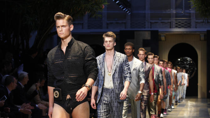 Models wear creations of Versace from the men's Spring-Summer 2013 collection, part of the Milan Fashion Week, unveiled in Milan, Italy, Saturday, June 23, 2012. (AP Photo/Luca Bruno)