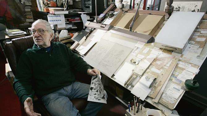 FILE - This Feb. 6, 2006 file photo shows Joe Kubert, life-long cartoonist and founder of the Joe Kubert School of Cartooning and Graphic Art, talks while seated at his drawing table at the school in Dover, N.J. Kubert, who co-created DC Comics' iconic Sgt. Rock character and Tor, and reinvigorated Hawkman, died Sunday, according to The Kubert School, which he founded in 1976 with his wife to train illustrators and artists. He was 85. (AP Photo/Mike Derer, file)