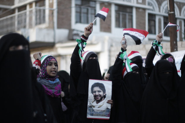 Protestors chant slogans during a rally to commemorate the one year anniversary of the people who were killed in clashes with Yemeni government forces in Sanaa, Yemen, Tuesday, Sept. 18, 2012. Yemeni government forces opened fire with anti-aircraft guns and automatic weapons on tens of thousands of protesters in the capital one year ago pushing for ouster of longtime ruler Ali Abdullah Saleh, killing several people and wounding dozens. (AP Photo/Hani Mohammed)