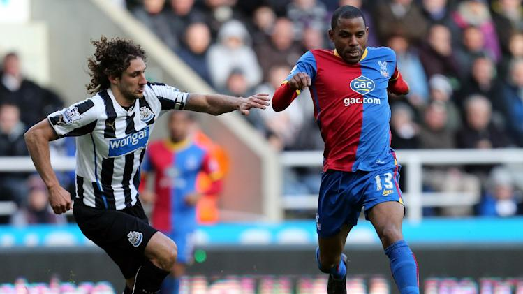 Crystal Palace's Jason Puncheon, right, vies for the ball with Newcastle United's captain Fabricio Coloccini, left, during their English Premier League soccer match at St James' Park, Newcastle, England, Saturday, March 22, 2014
