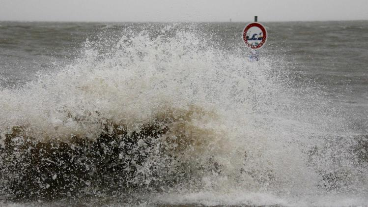 Waves at the North Sea are pictured at a quay wall in Cuxhaven