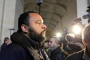 "French humorist Dieudonne M'bala M'bala, also known as Dieudonne, arrives for the trial of Ilich Ramirez Sanchez, known as ""Carlos the Jackal"", at Paris' special court"