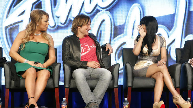 "Mariah Carey, Keith Urban and Nicki Minaj from ""American Idol"" attend the Fox Winter TCA Tour at the Langham Huntington Hotel on Tuesday, Jan. 8, 2013, in Pasadena, Calif. (Photo by Todd Williamson/Invision/AP)"