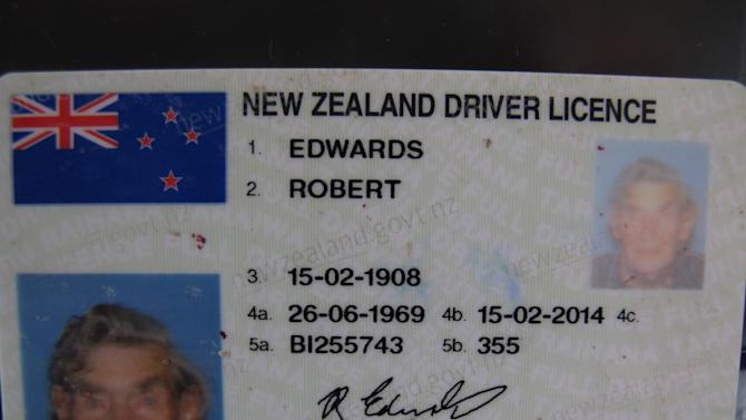 This Sunday, May 26, 2013 photo shows the current license of New Zealand's oldest driver Bob Edwards, in Ngataki, New Zealand. Edwards, the oldest licensed driver in New Zealand and one of the oldest in the world, has been driving for 88 of his 105 years and has no plans to give it up, just as he intends to keep working out every morning in his home gym. (AP Photo/Nick Perry)