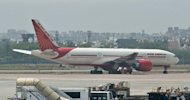 "An Air India plane is seen parked on the tarmac at the Indira Gandhi International Airport in New Delhi on May 11. India's state-run flagship carrier Air India is to start ""conciliatory"" talks with pilots this week after they ended a near two-month strike, the Indian Pilots Guild (IPG) said Wednesday"