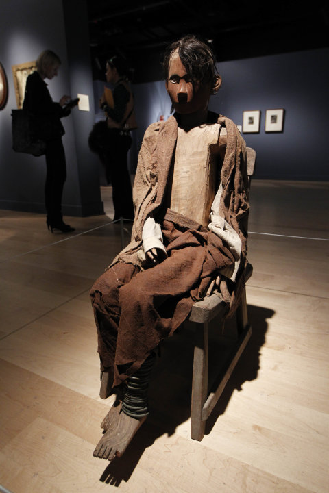 An Indonesian Tau-Tau memorial sculpture is seen on display at an exhibition 'Death: The Richard Harris Collection' at the Wellcome Collection gallery in London, Wednesday, Nov. 14, 2012. (AP Photo/Sa