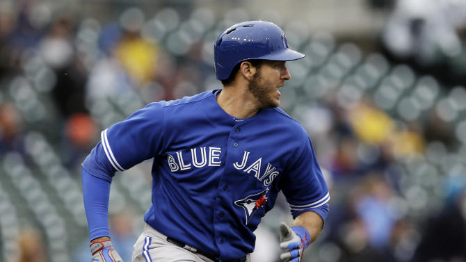 Toronto Blue Jays' J.P. Arencibia rounds first base after hitting a three-run double against the Detroit Tigers in the seventh inning of a baseball game in Detroit, Wednesday April 10, 2013. (AP Photo/Paul Sancya)