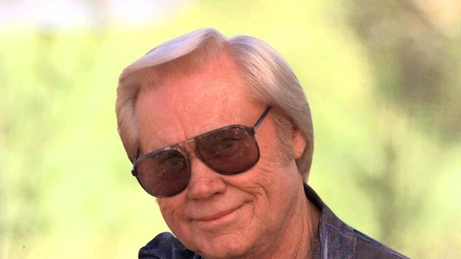 "FILE - In this April 1996 file photo, George Jones is shown in Nashville.   Jones, the peerless, hard-living country singer who recorded dozens of hits about good times and regrets and peaked with the heartbreaking classic ""He Stopped Loving Her Today,"" has died. He was 81. Jones died Friday, April 26, 2013 at Vanderbilt University Medical Center in Nashville after being hospitalized with fever and irregular blood pressure, according to his publicist Kirt Webster. (AP Photo/Mark Humphrey, file)"