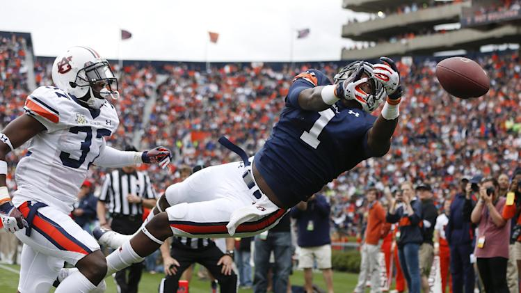Auburn wide receiver Trovon Reed (1) cannot make the catch as Auburn defensive back Kamryn Melton (37) defends in the first half of the annual A Day spring intrasquad NCAA college football game on Saturday, April 19, 2014, in Auburn, Ala