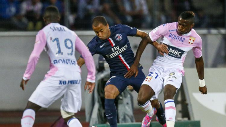 Lucas of Paris St-Germain challenges N'Sikulu of Evian Thonon Gaillard during their French Ligue 1 soccer match in Annecy