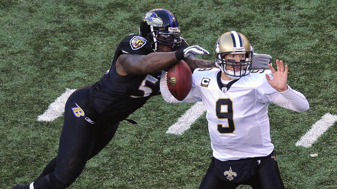 Baltimore Ravens linebacker Terrell Suggs, left, strips the ball from New Orleans Saints quarterback Drew Brees during the second half of an NFL football game in Baltimore, Sunday, Dec. 19, 2010. (AP Photo/Nick Wass)